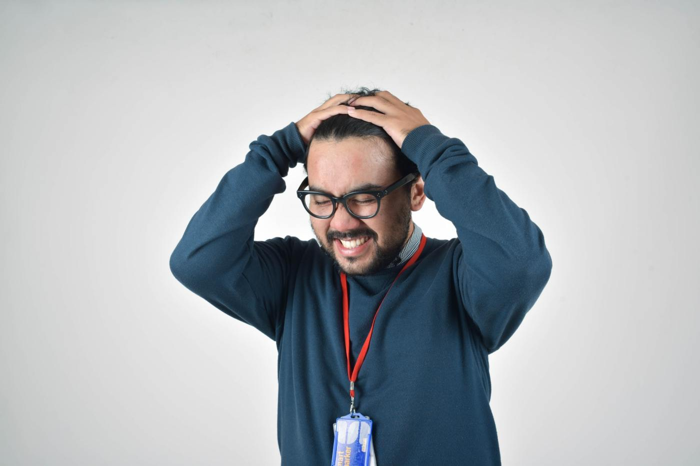 Guy who appears to be frustrated with office coworkers and having to make the tough decision about firing someone