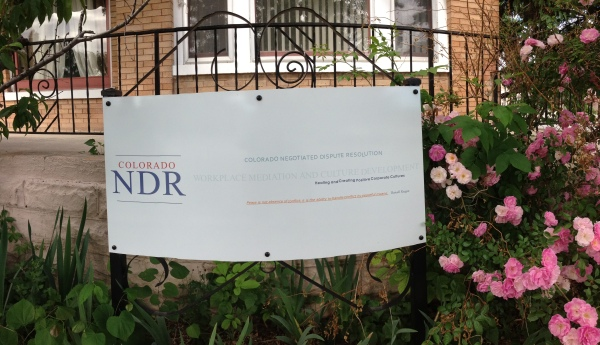 Photo of Colorado NDR dispute resolution sign in rose garden