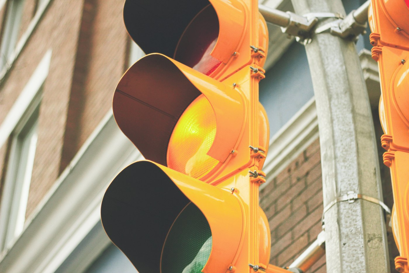 yellow traffic light, how we move through business ethics