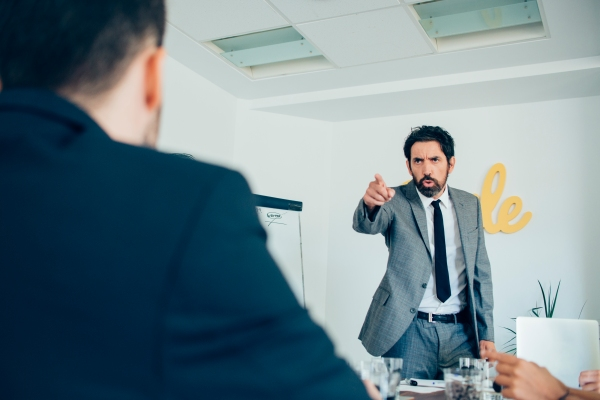 angry employee pointing at another person in a meeting can be an indication of when conflict resolution in the workplace is needed